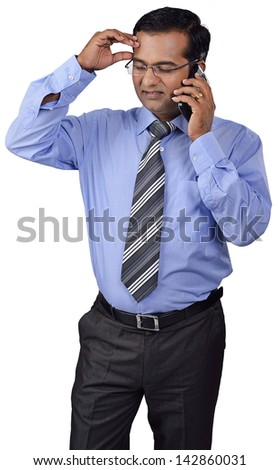 frustrated business man talking on the phone - stock photo
