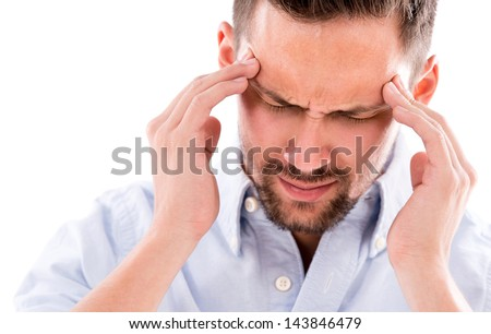 Frustrated business man with a headache - isolated over white - stock photo