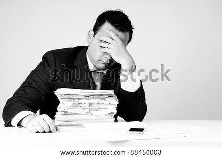 frustrated business man with administration - stock photo