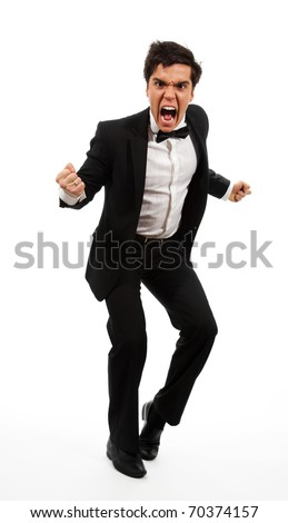 Frustrated business man with wide open mouth and gesticulating with hands and fists, isolated on white
