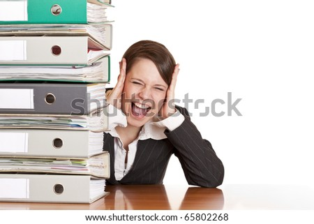 Frustrated business woman cries in office behind behind a folder stack. Isolated on white background. - stock photo