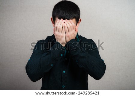 Frustrated businessman holding head in his hands - stock photo