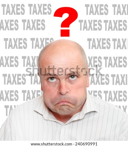 Frustrated businessman in tax time.  - stock photo