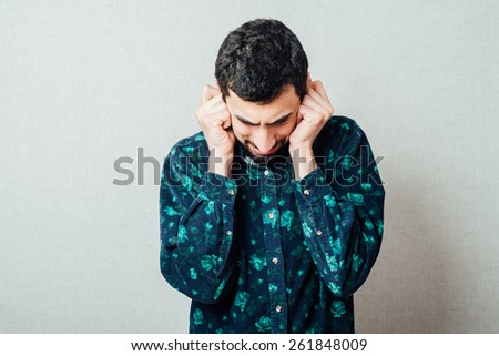 Frustrated businessman is covering his ears ,Shut up! - stock photo