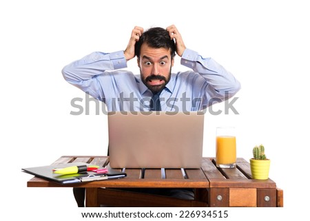 frustrated businessman over white background  - stock photo