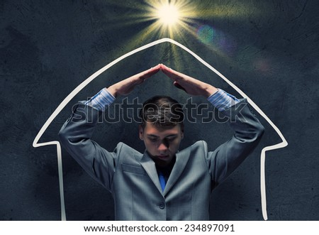 Frustrated businessman protecting his head with arms - stock photo