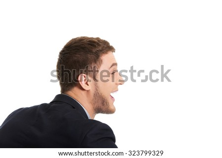 Frustrated businessman screaming on someone.