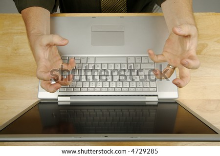 Frustrated businessman shows his frustration while working on his laptop. - stock photo
