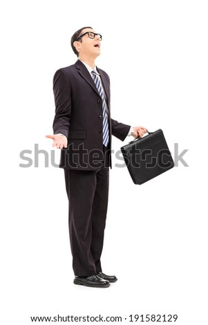 Frustrated businessman talking to god isolated on white background - stock photo