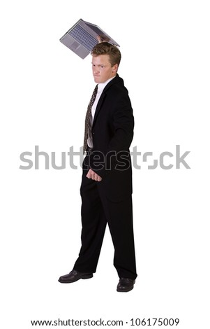 Frustrated Businessman Throwing His Laptop - Isolated Background - stock photo
