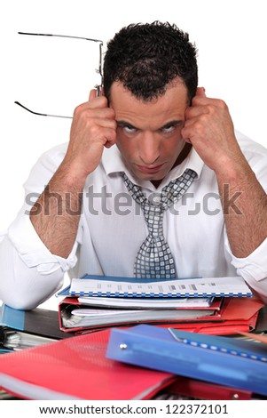 Frustrated businessman with files - stock photo