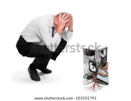 Frustrated businessman with his destroyed computer. - stock photo