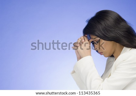 Frustrated businesswoman with her head in her hands - stock photo