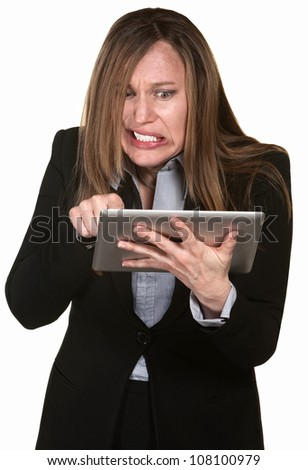 Frustrated businesswoman with tablet over white background - stock photo