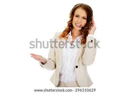Frustrated call center woman talking with customer. - stock photo