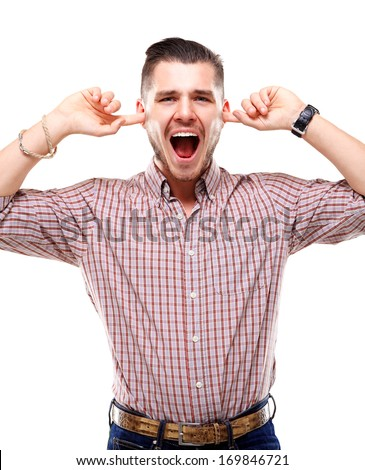 Frustrated Casual young man closing his ears with his hands  - stock photo