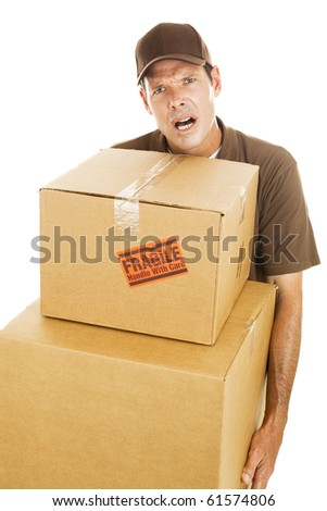 Frustrated delivery man or mover carrying two large boxes.  Isolated on white. - stock photo