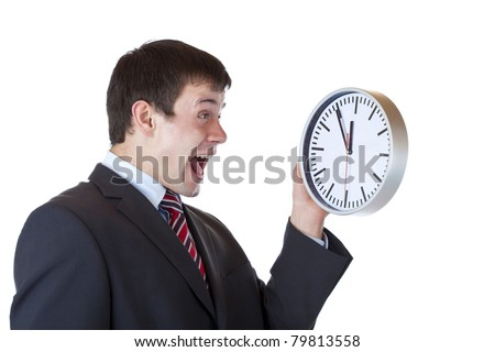 Frustrated employee holds clock in front and shouts enervated.Isolated on white background. - stock photo