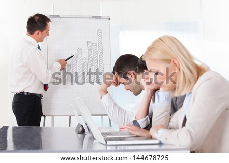 Frustrated Employees In The Office Business Meeting - stock photo