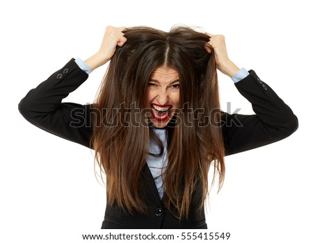 Frustrated, extremely angry young business woman pulling her hair