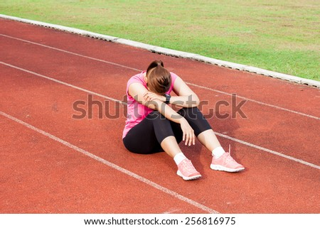 Frustrated female runner - stock photo