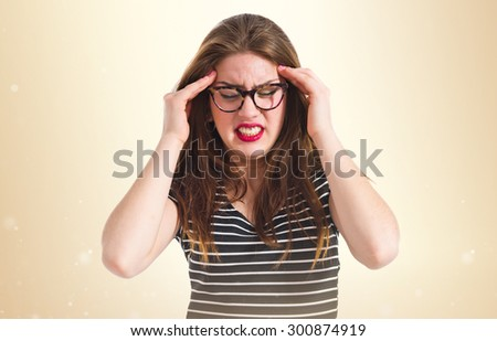 frustrated girl over ocher background - stock photo