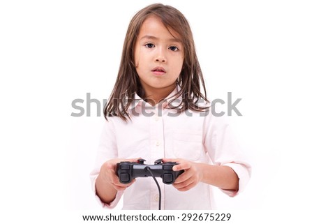 frustrated little girl gamer experiencing game over - stock photo