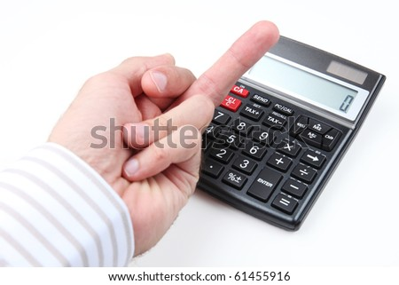 Frustrated male gives the middle finger to a calculator