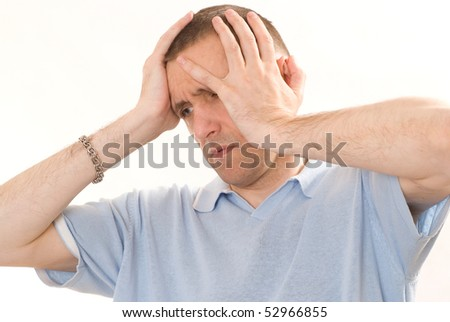 frustrated man in a blue on a white background - stock photo