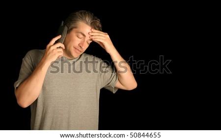 Frustrated man on the phone - stock photo