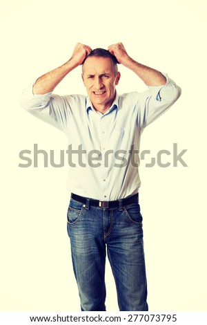 Frustrated man pulling his hair.  - stock photo