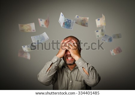 Frustrated man. Taxes and debts. Expressions, feelings and moods. Falling Euro. - stock photo
