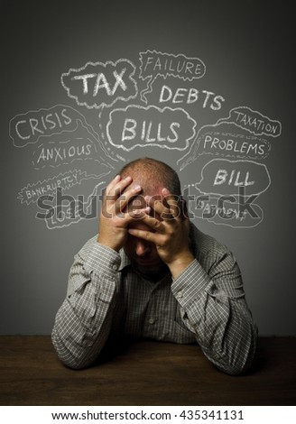 Frustrated man. Taxes, debts and other problems. - stock photo