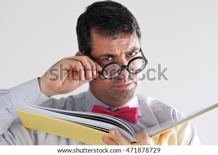 Frustrated man teacher looks at the camera. Education concept. real people copy space