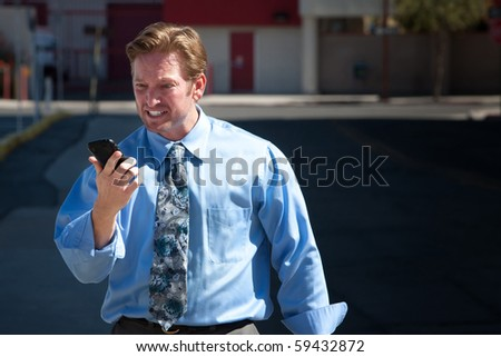 Frustrated man tries desperately to make a phone call. - stock photo