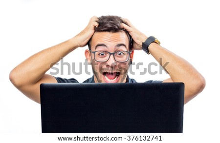 Frustrated man with a laptop against white background