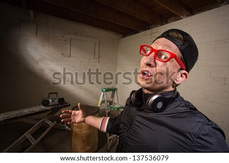 Frustrated man with red eyeglasses and hat - stock photo
