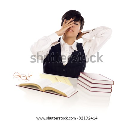Frustrated Mixed Race Young Adult Female Student At White Table with Books and Paper Isolated on a White Background. - stock photo