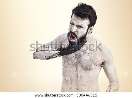 Frustrated monster over ocher background - stock photo