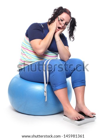 Frustrated overweight woman with a weighing machine.  - stock photo