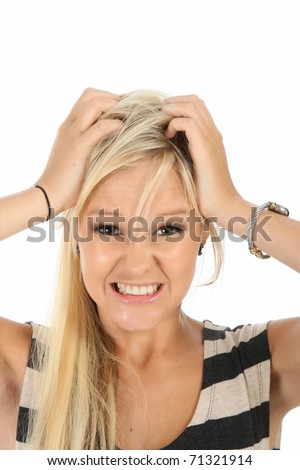 Frustrated pretty blonde woman with hands on her head - stock photo