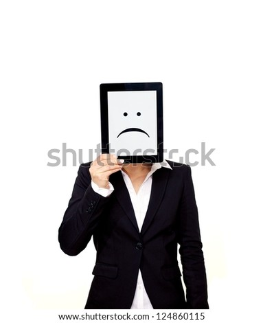 Frustrated professional holding up a digital tablet with a sad emoticon on screen - stock photo