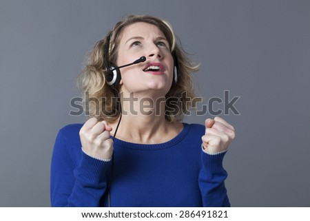 frustrated 20s blonde entrepreneur loosing her temper on the phone - stock photo