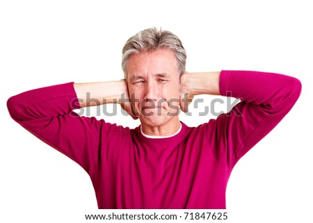 Frustrated senior man closing his ears with his hands