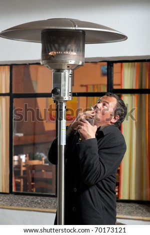 Frustrated smoker banned by law to smoke outside the pub - stock photo