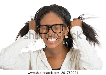 Frustrated stressed woman with glasses. Headshot unhappy overwhelmed girl having headache bad day pulling her hair out isolated white background. Negative emotion face expression feelings perception - stock photo
