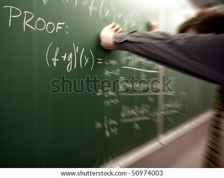 Frustrated student solving a problem a math problem - stock photo