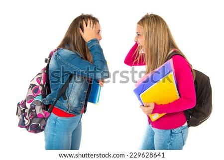 frustrated students over isolated white background - stock photo