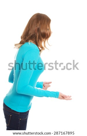 Frustrated teenage woman making fists - stock photo