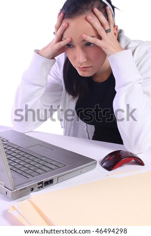 Frustrated Teenager with a Laptop Looking at the Computer - stock photo